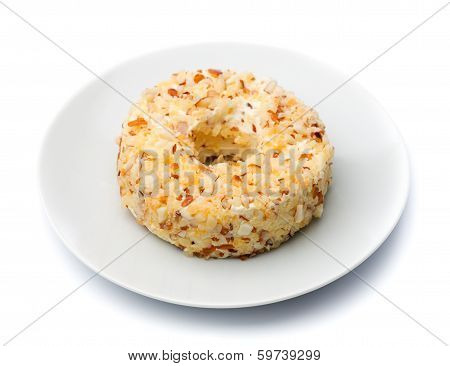 Round Sweet Dessert Cheese With Nuts And Pineapple On A White Plate.