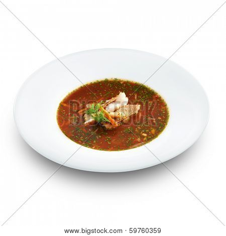 Hot delicious tomato soup with fish and rice served with leek and parsley in a white bowl. Isolated on white.  poster