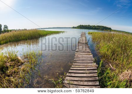 Summer Landscape With Lake And Old Wooden Bridge
