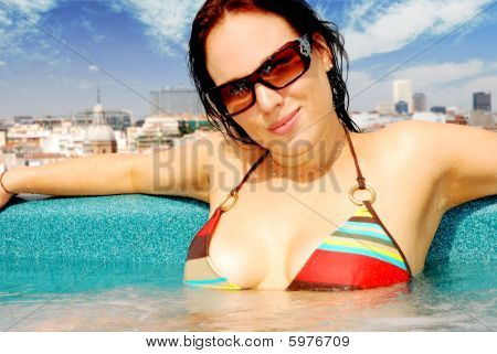 attractive brunette in a jacuzzi on a rooftop