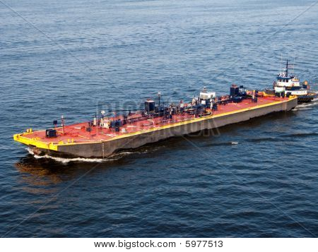 Barge Pushed By A Tugboat