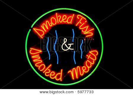 Smoked meats and fish neon sign isolated on black poster