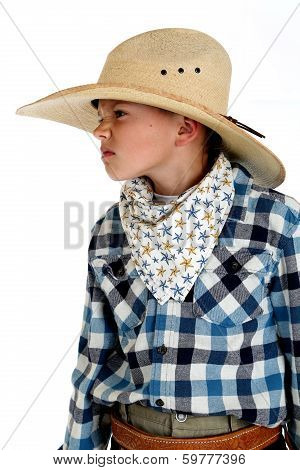 Young Cowboy With A Sneering Expression Wearing A Huge Cowboy Hat