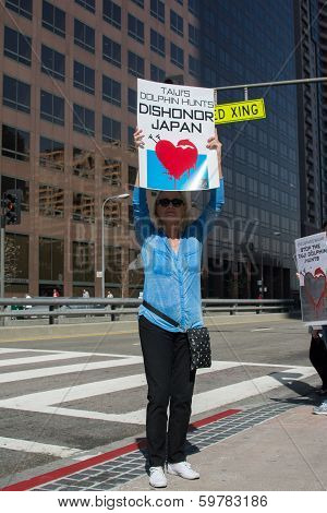 Activist in front of the consulate of Japan in Los Angeles to protest the dolphins slaughter in Tai