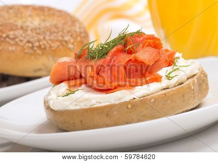 Delicious freshly baked Everything Bagel with cream cheese, lox and dill served with fresh orange juice