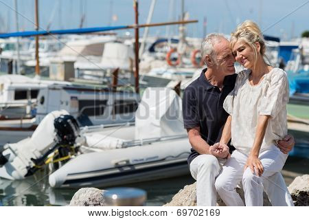 Affectionate Couple Relaxing In A Harbour