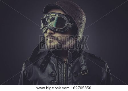 ww2 pilot dressed in vintage style leather cap and goggles poster