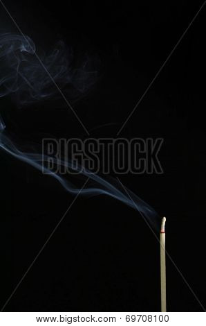 Incense Stick With Smoke On Black Background