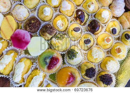 Various Stuffed Puffs With Cream Decorated