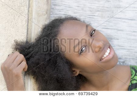 Young Afro beauty detangling her hair