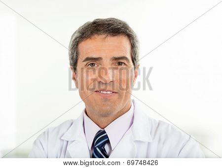 Portrait of confident male scientist in laboratory