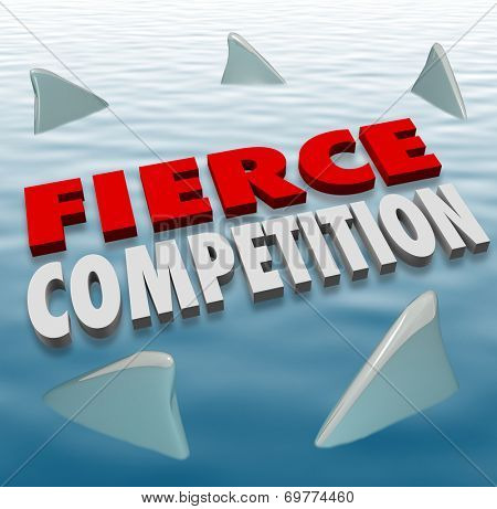 Fierce Competition words in 3d letters on water with shark fins as formidable competitors in a game or challenge