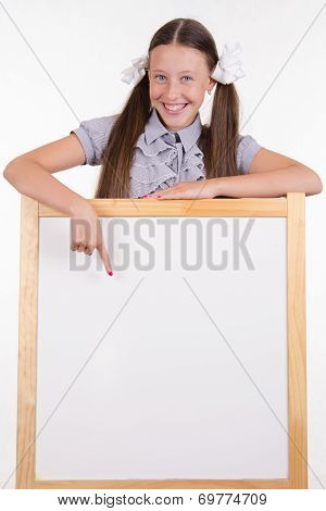 Teen Girl Advertises Inscription On The Stand