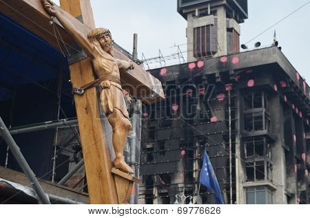 KIEV, UKRAINE - APR 7, 2014: Second crucifixion of Jesus.Burned downtown of Kiev.Rioters camp. Riot in Kiev and Western Ukraine.April 7, 2014 Kiev, Ukraine