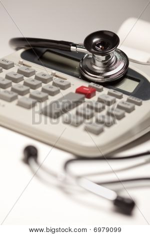 Black Stethoscope On Calculator