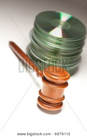 Stack Of Cd Rom Or Dvd Discs And Gavel