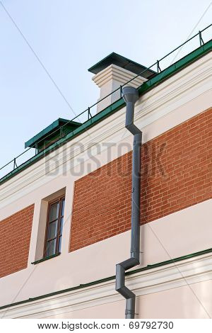 Newly Installed Gutter And Pipe
