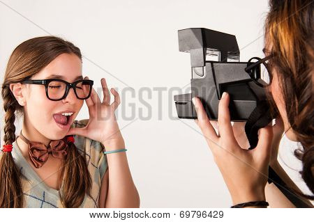 Young Nerdy Girls Using Instant Camera.