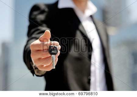 Businessman Holding A Car Key In His Hand - New Car Buy Sale Concept