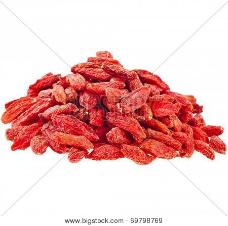 Heap pile of Goji berries. The addition to the tea beverage  isolated on white background