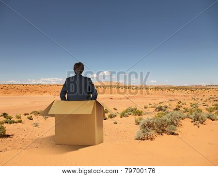 Businessman Sitting In Box