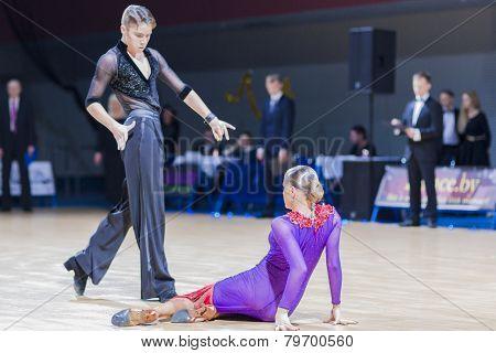 Professional belarussian dance couple of Shmidt Danila and Gumenyuk Alina performs Youth-2 Latin-Ame