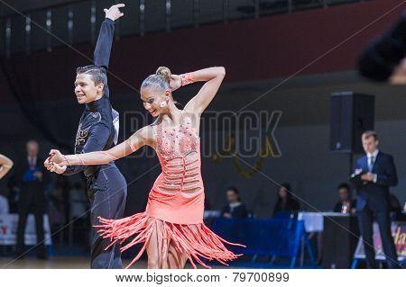 Professional Belarussian dance couple of Kolesnev Sergey and Buldyk Arina performs Adult Latin-Ameri