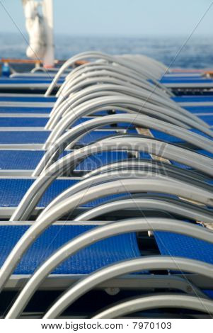 stock pictures of chairs used on the deck of a cruise ship poster