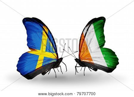 Two Butterflies With Flags On Wings As Symbol Of Relations Sweden And Cote Divoire