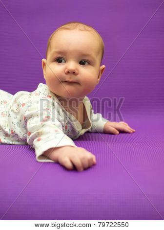 A breastfed baby for the first time tries to crawl. poster