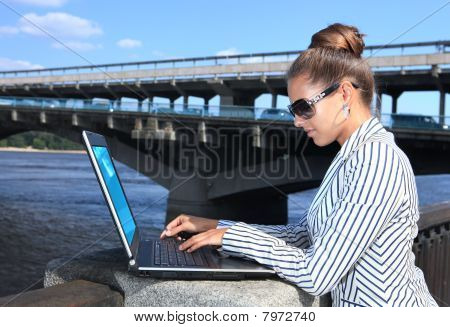 Businesswoman With Laptop On Quay