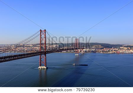 The 25th of April - 25 de Abril suspension bridge and the Tagus or Tejo River viewed from Almada towards Lisbon, Portugal. poster