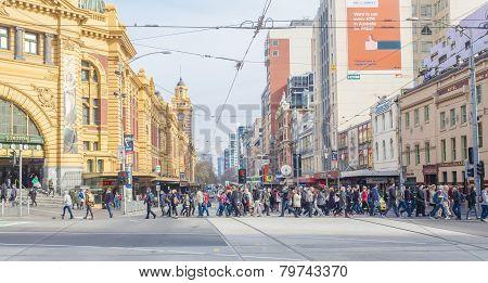 Busy crosswalk outside Flinders Street Station in Melbourne