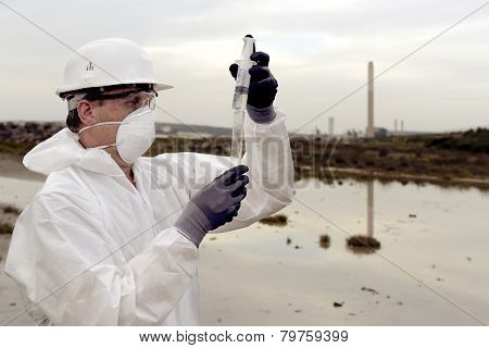 Worker in a protective suit examining pollution in the water at the industry. poster
