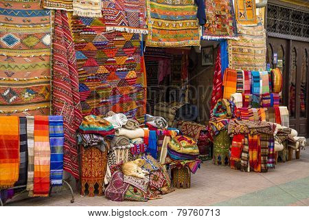 Colorful fabrics on the Agadir market in Morocco poster