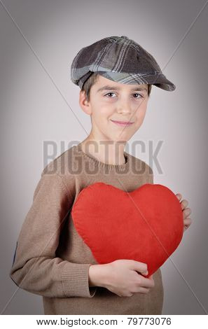 Young boy holding a plush red heart