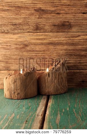 Two Candles Placed In Very Old Wooden Bars