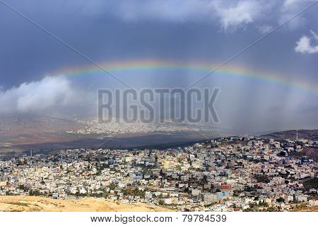 rainbow over the arab village Cana of Galilee ( Kafr Kanna ) in Israel , place where Christ showed first miracle poster