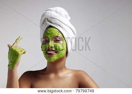 Woman With Avocado Mask On Her Face And Hand
