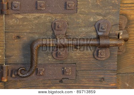 Rusty Lock With Deadbolt To Close The Door Of The Medieval Castle