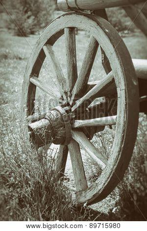 Vintage Stylized Photo Of Wooden Cart Wheel