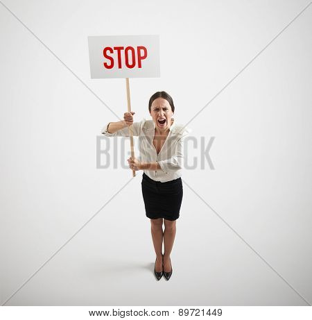 view from above of screaming businesswoman holding placard with stop sign over light grey background