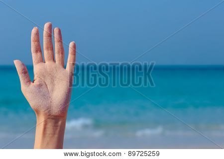 Female open hand on sea background