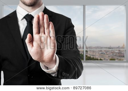 Businessman In Office Hand Stop Gesture