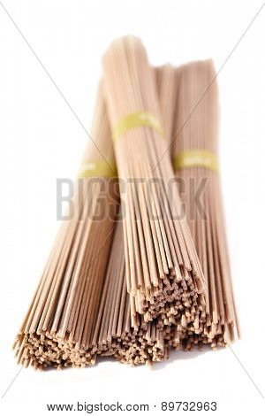 Dried soba noodles isolated on white background