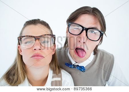 Funny geeky hipsters grimacing on white background