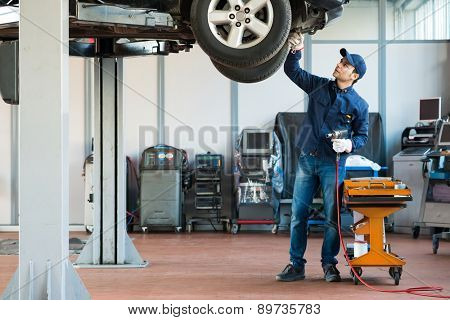 Portrait of a mechanic at work in his garage