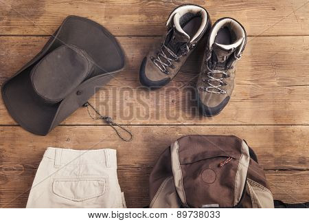 Equipment for hiking on a wooden floor background poster