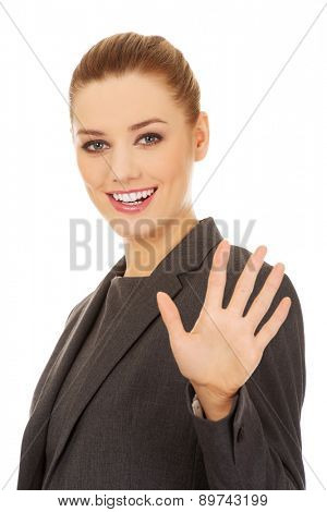 Young business woman making stop sign with her hand.