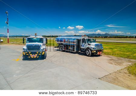 Fuel trucks parked in front of aircraft at international airport el Dorado, Bogota Colombia